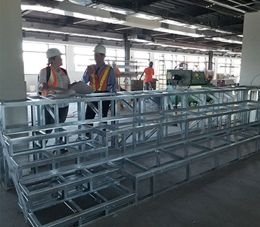 Employees working on steel structure